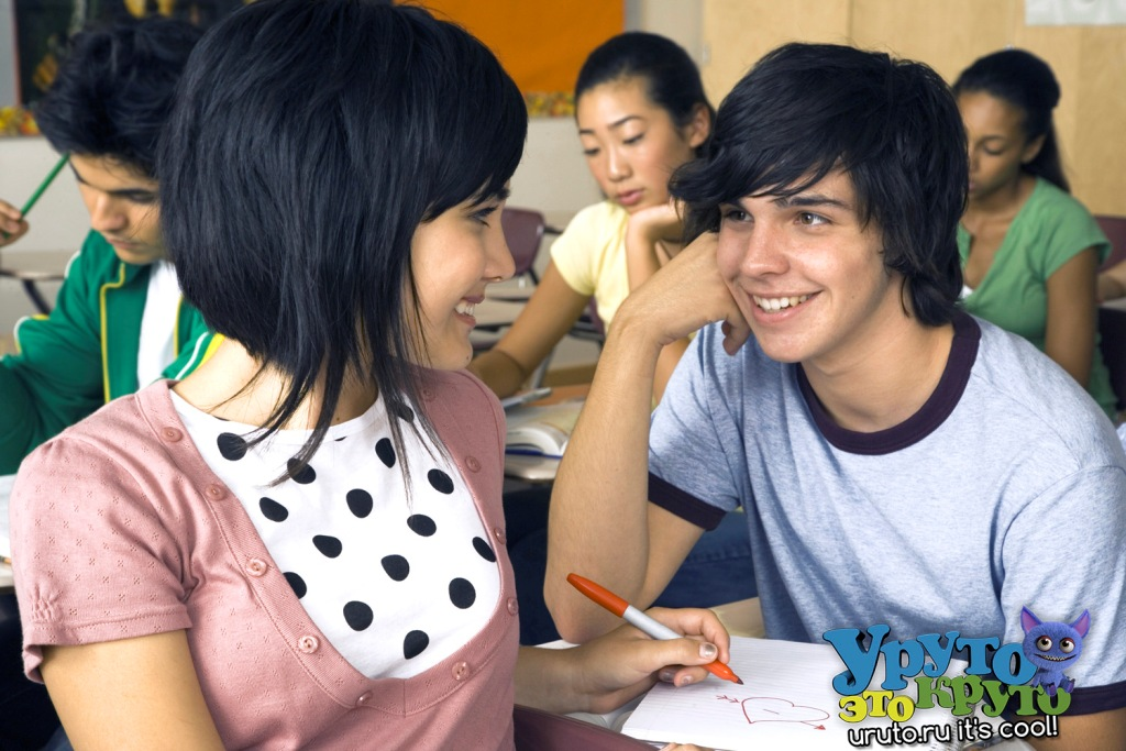 girl and boy flirt in class